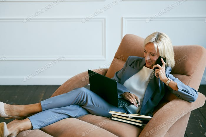Successful Mature Businesswoman Speaking by Phone