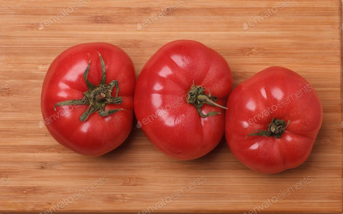 three big fresh rose tomatoes