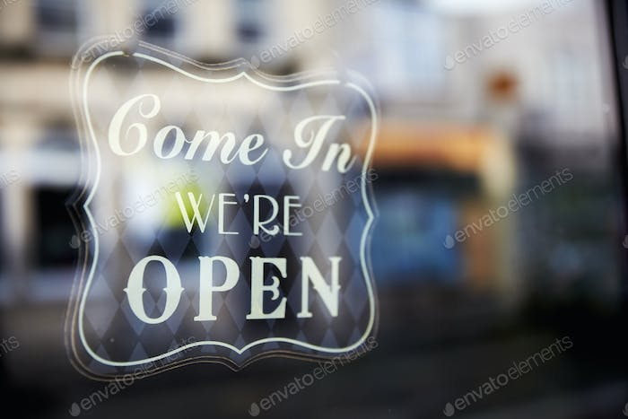 A sign etched in glass, Come In, We're Open.