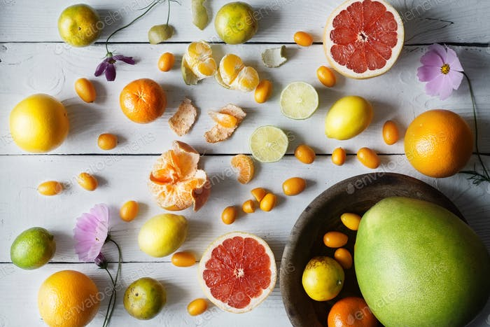 Citrus mix on the white wooden background  top view