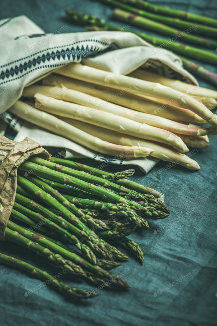 Fresh green and white asparagus in towel, selective focus