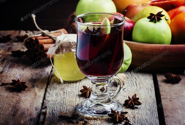 Apple and vanilla hot mulled wine with honey, anise, cinnamon, cloves, zest in a glass