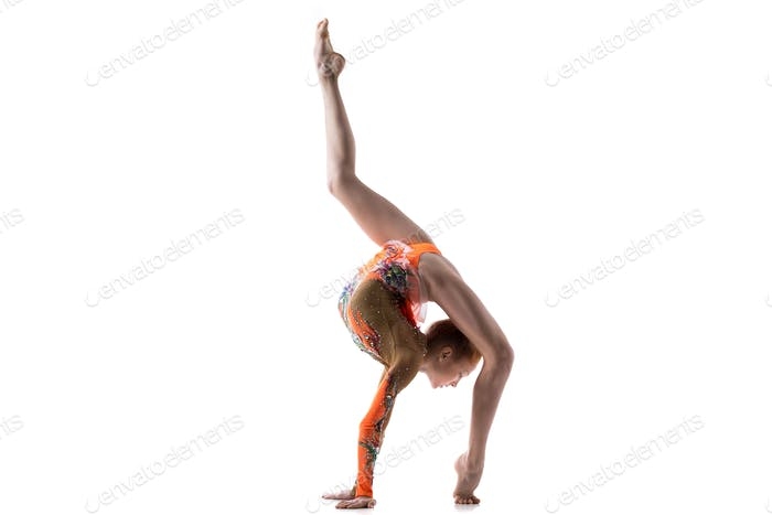 Teenage dancer girl doing back walkover