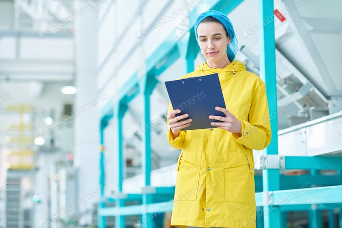 Modern Young Woman at Factory