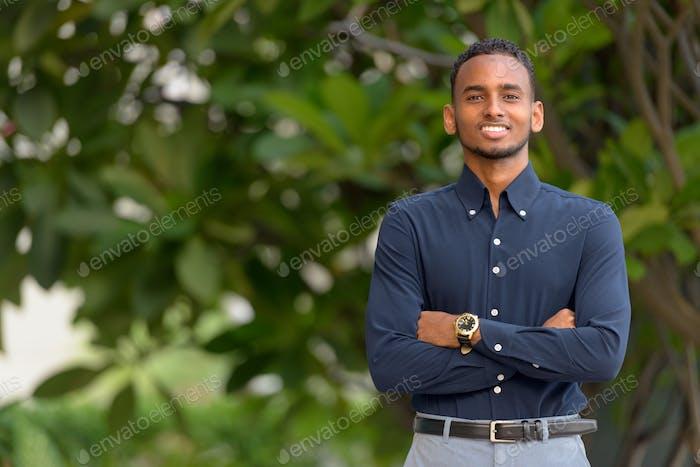 Handsome African businessman outdoors at rooftop garden