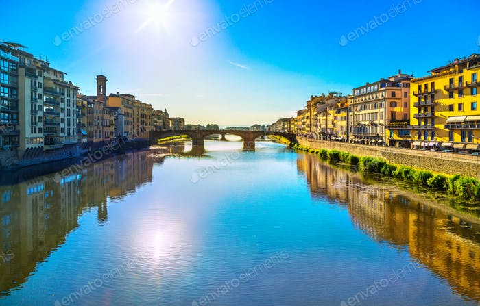 Santa Trinita Bridge on Arno river, sunset landscape. Florence,