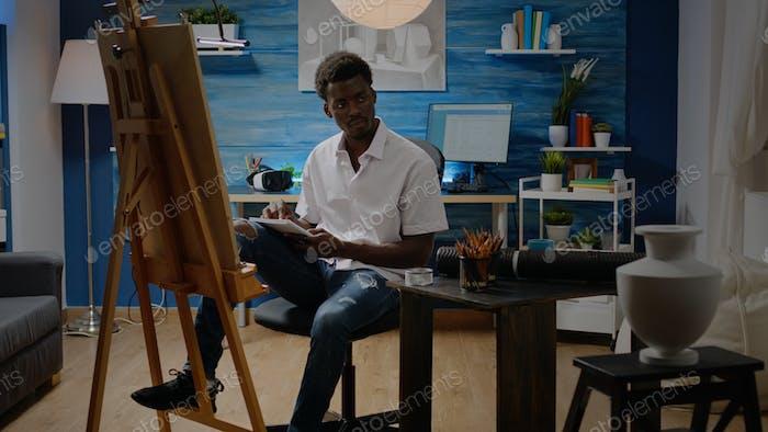 Man of african american ethnicity designing sketch
