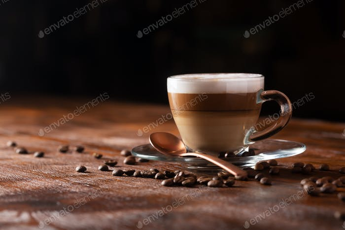 Cup of Coffe With Milk on a Dark Background. Hot Latte or Cappuccino Prepared With Milk
