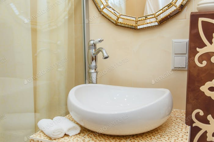 Luxurious bathroom plumbing in hotel room. Bathroom interior elements.