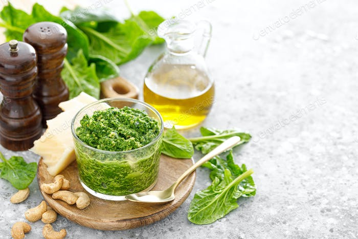 Spinach pesto sauce with cashew, parmesan cheese and olive oil