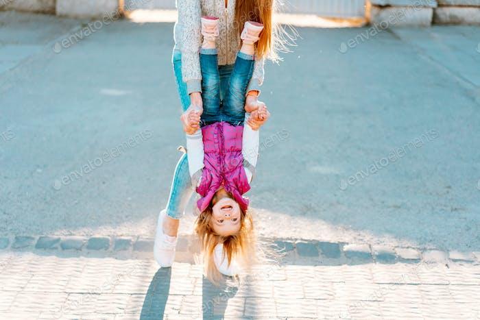 Mom and girl playing, having fun