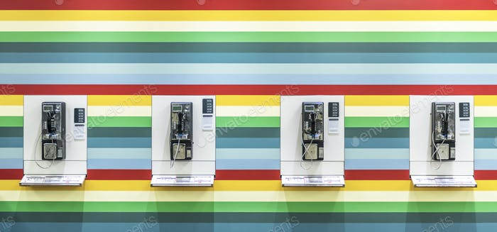 Payphone isolated on a color background