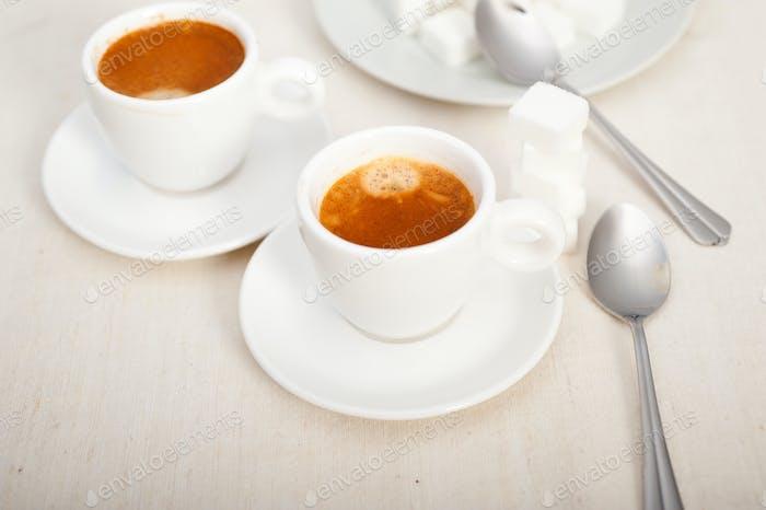Italian espresso coffee and sugar cubes