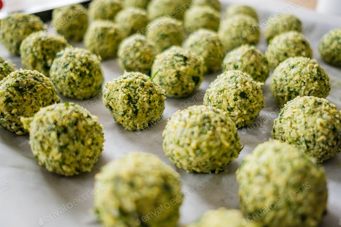 Close up falafel cooking process