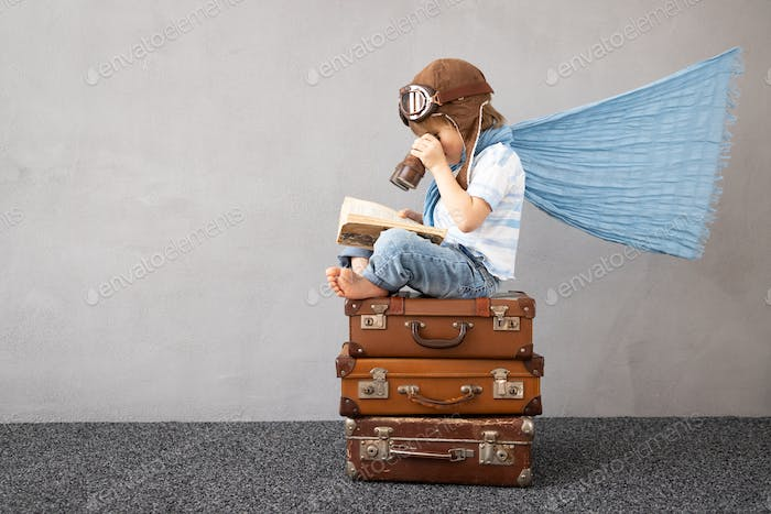 Happy child dreaming about summer vacation and travel