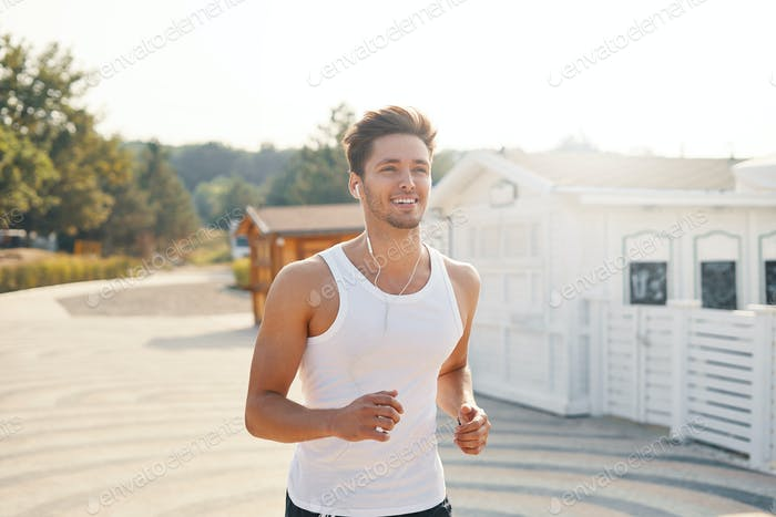 Athletic runner man with seductive, perfect smile