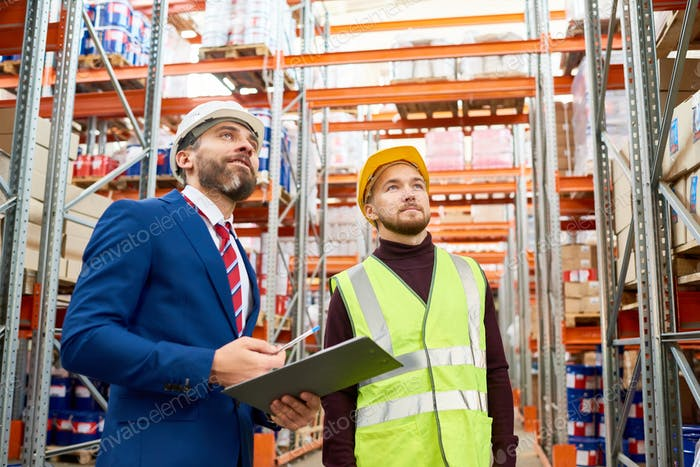 Warehouse Manager Instructing Worker
