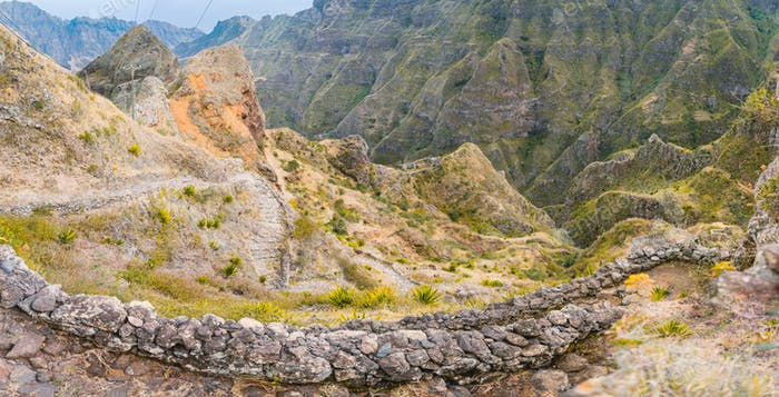 Vertiginous steel trekking trails leads between huge rocks down to the Coculi valley. Santo Antao