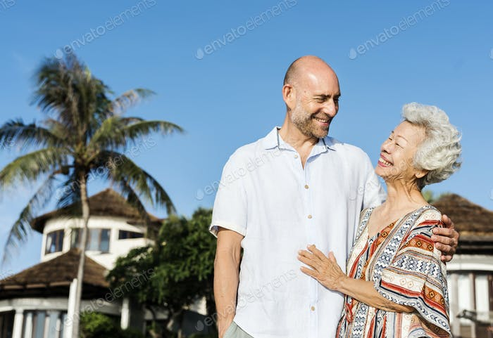 Mature mother and son at the beach