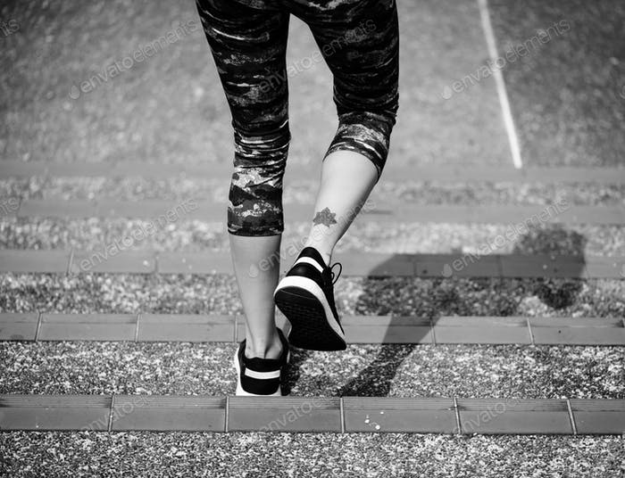 Woman walking down the stair