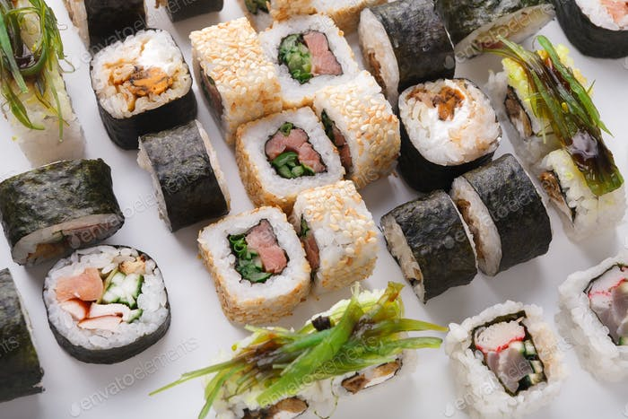 Set of sushi, maki and rolls isolated on white background closeup