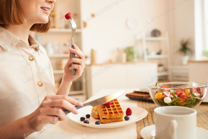 Woman Enjoying Dessert in Kitchen