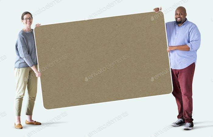 People holding a blank board