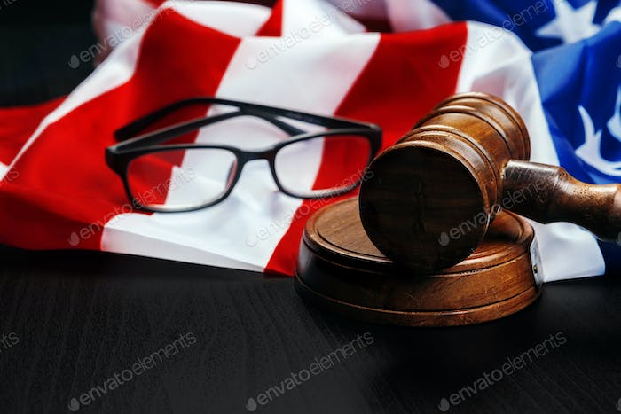 Gavel on wooden table with USA flag