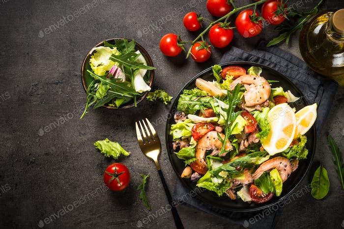Seafood salad at black table