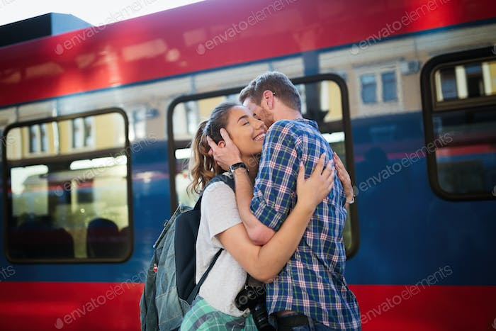 Beautiful couple hugging after long journey