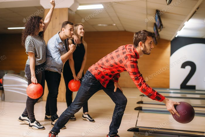 Male bowler throws ball, throwing in action