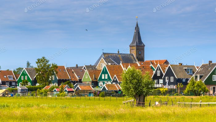 Church towering above Village with colorful wooden houses