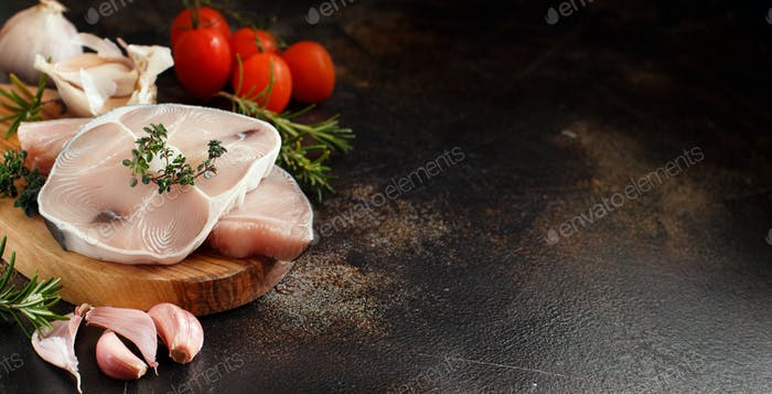 Two shark steak with vegetables and herbs