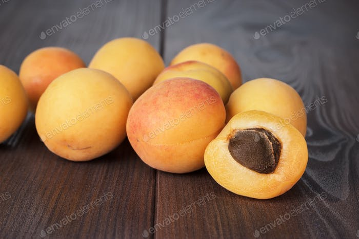 Some Fresh Apricots On Brown Table