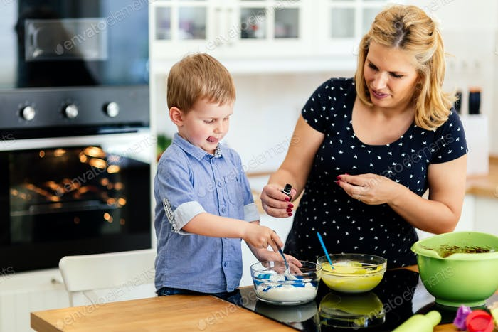 Thumbnail for Happy mother and child in kitchen