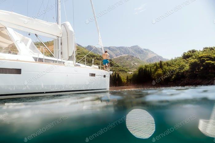 man yachting blue lagoon