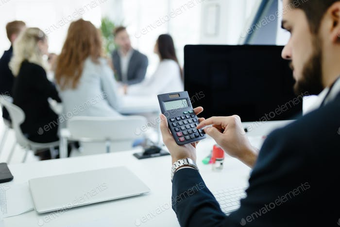 Accountant checking statistics of company