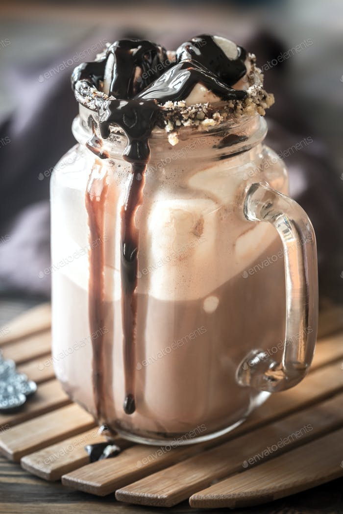 A jar of hot chocolate with marshmallows