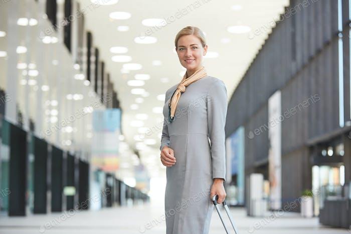 Smiling Flight Attendant in Airport
