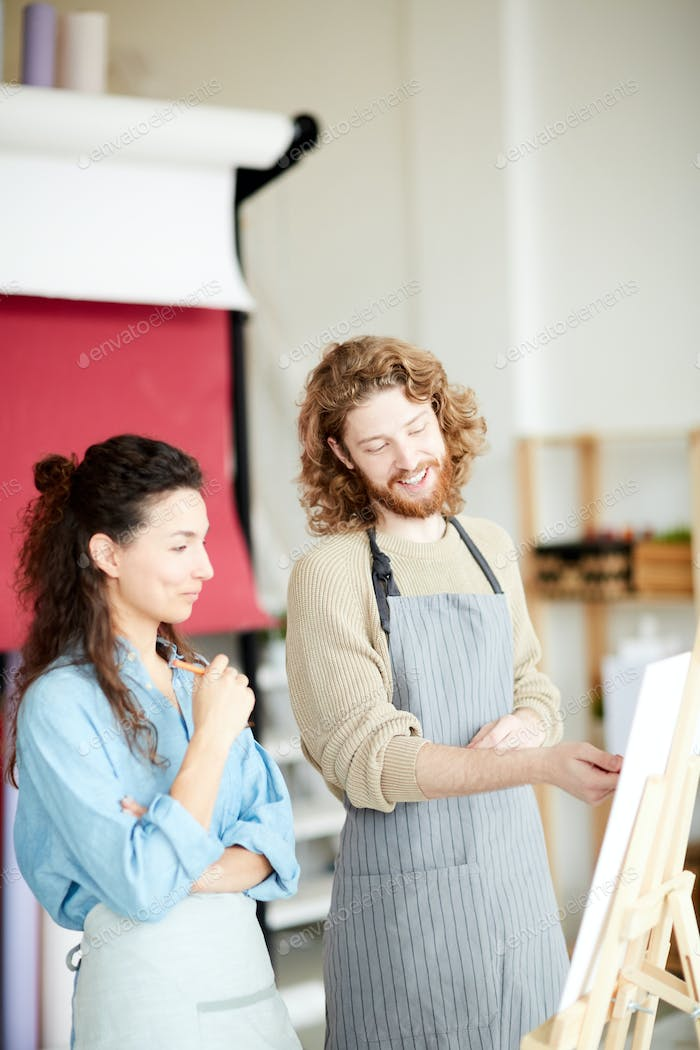 Colleagues by easel