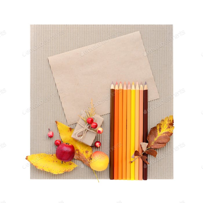 Autumn background with blank brown paper and colour pencils. Top