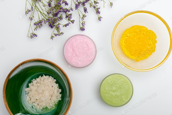 Close-up view of ingredients for homemade cosmetics isolated on white
