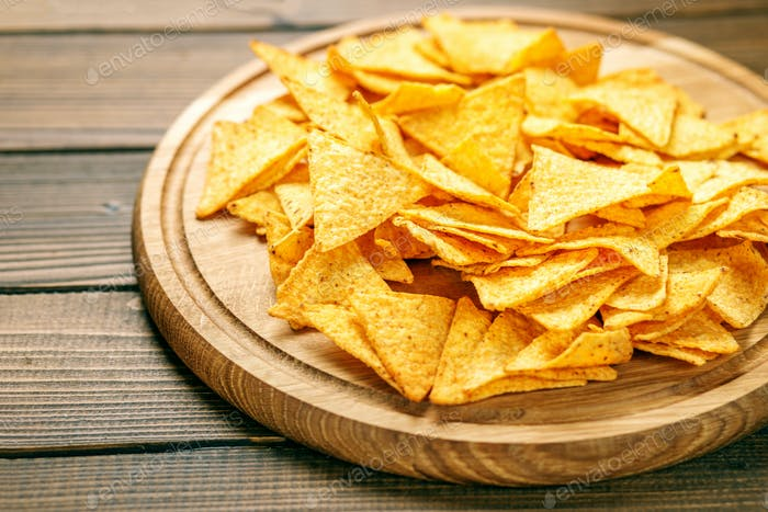 Sharp Mexican Nachos Chips. Concept - bad food, cafe, pub, party