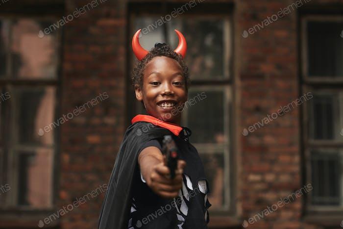 Cute Devil With Toy Gun