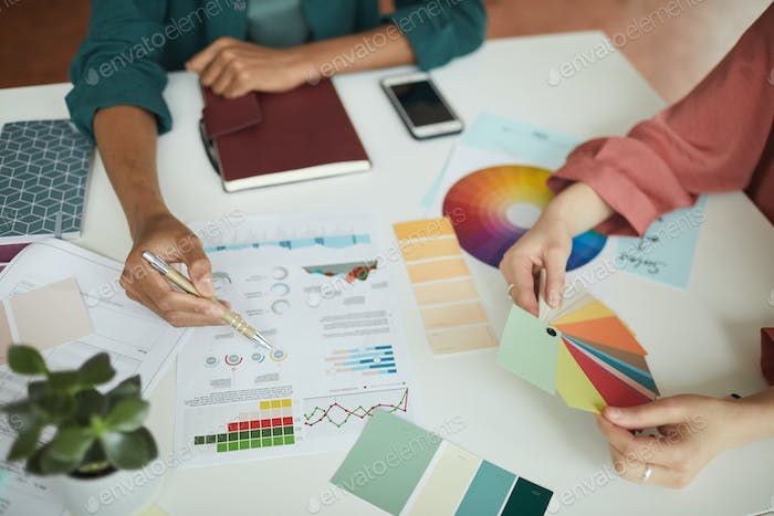 People discussing business graphics