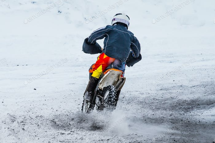 Racer motorcycle race in winter