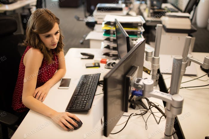 Businesswoman working on computer at office