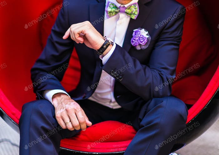 Groom sitting