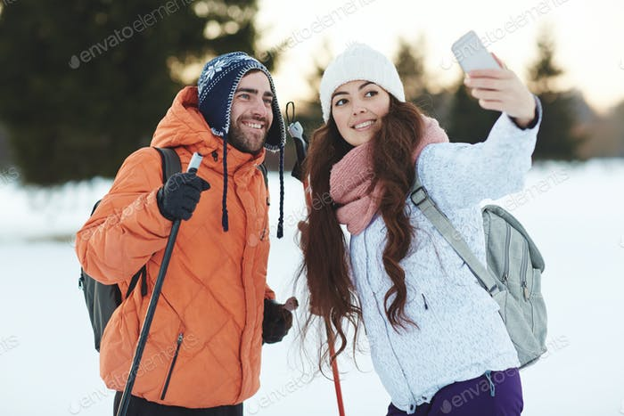 Selfie of ski adventurers