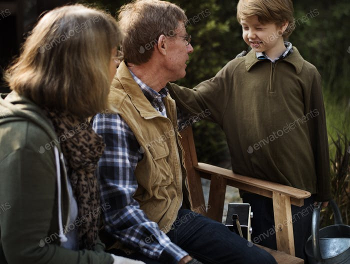 Grandparents and Grandson Talking Together at Garden